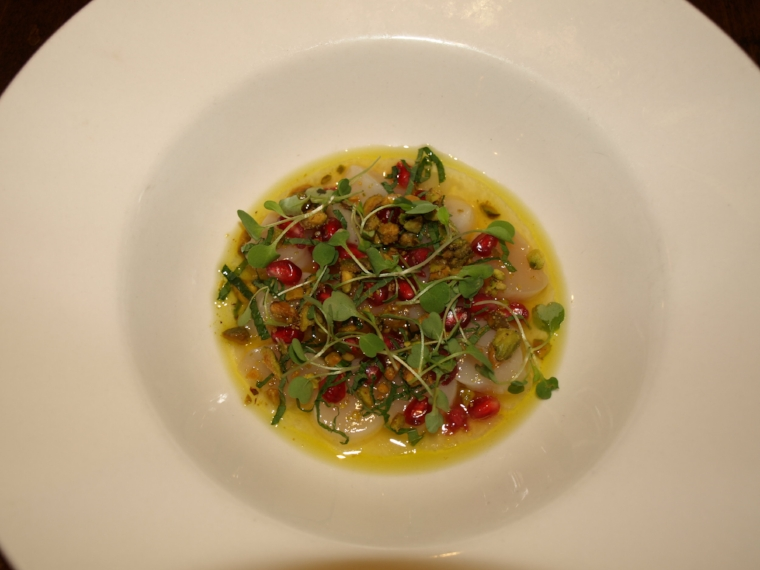 The Peconic Bay Scallop Crudo ($16) is served with pomegranate, pistachios, yuzu, white soy and mint.   Long Islander News Photo/Connor Beach