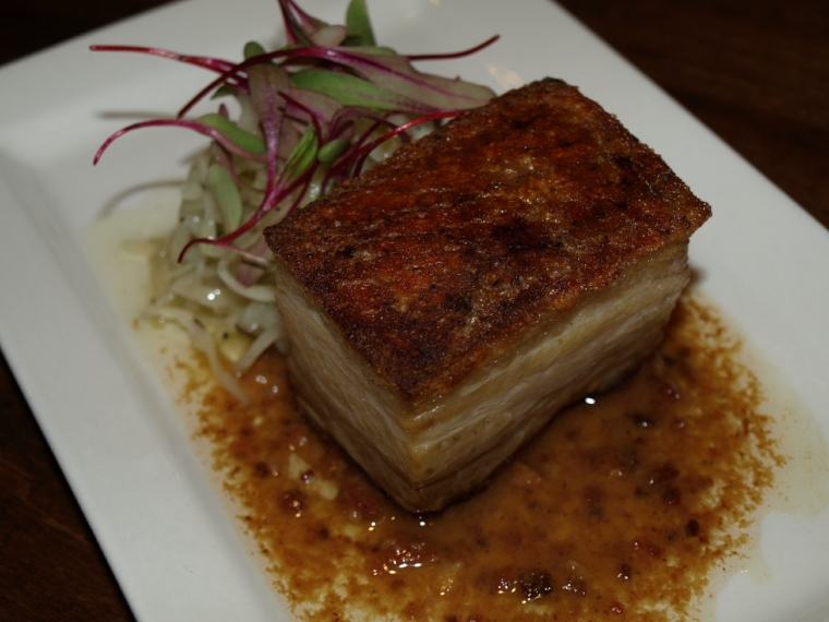 The Berkshire Pork Belly ($15) is served with a cabbage and apple slaw and a maple bacon bourbon vinaigrette.   Long Islander News Photo/Connor Beach