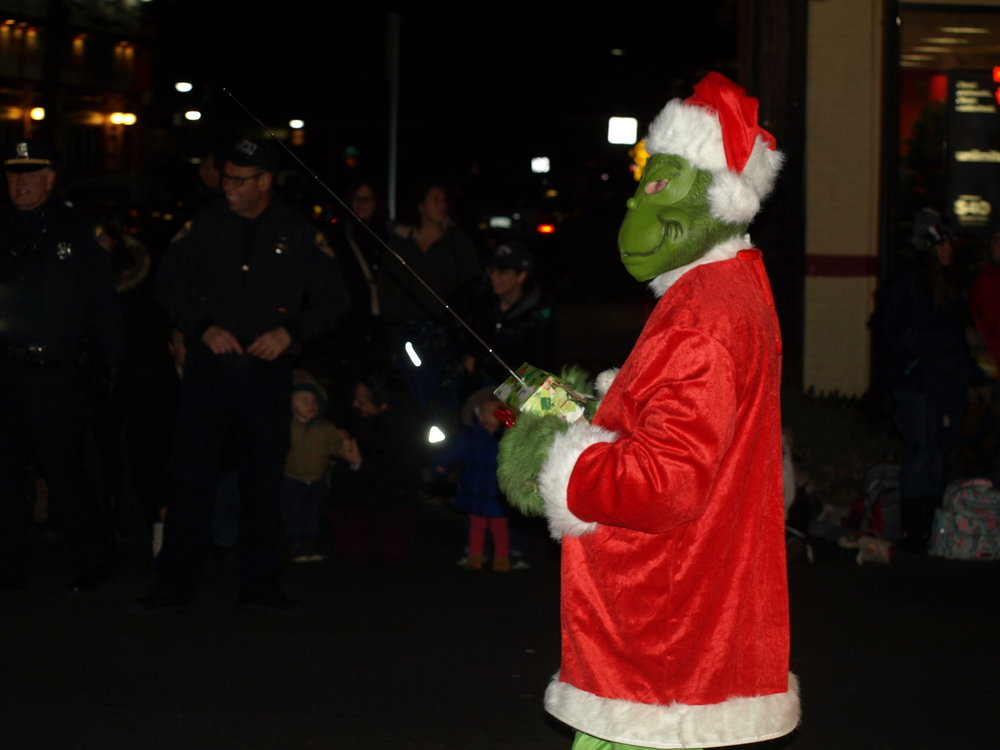 Even the Grinch couldn't find a way to steal the fun from Sunday's Huntington Holiday Parade.   Long Islander News Photo/Connor Beach