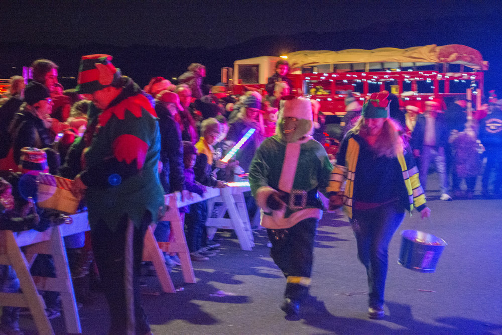 The Grinch was part of Santa's crew on Friday, helping to pass out candy canes, while also causing some of the Grinch's usual brand of trouble.  Long Islander News Photo/Andrew Wroblewski