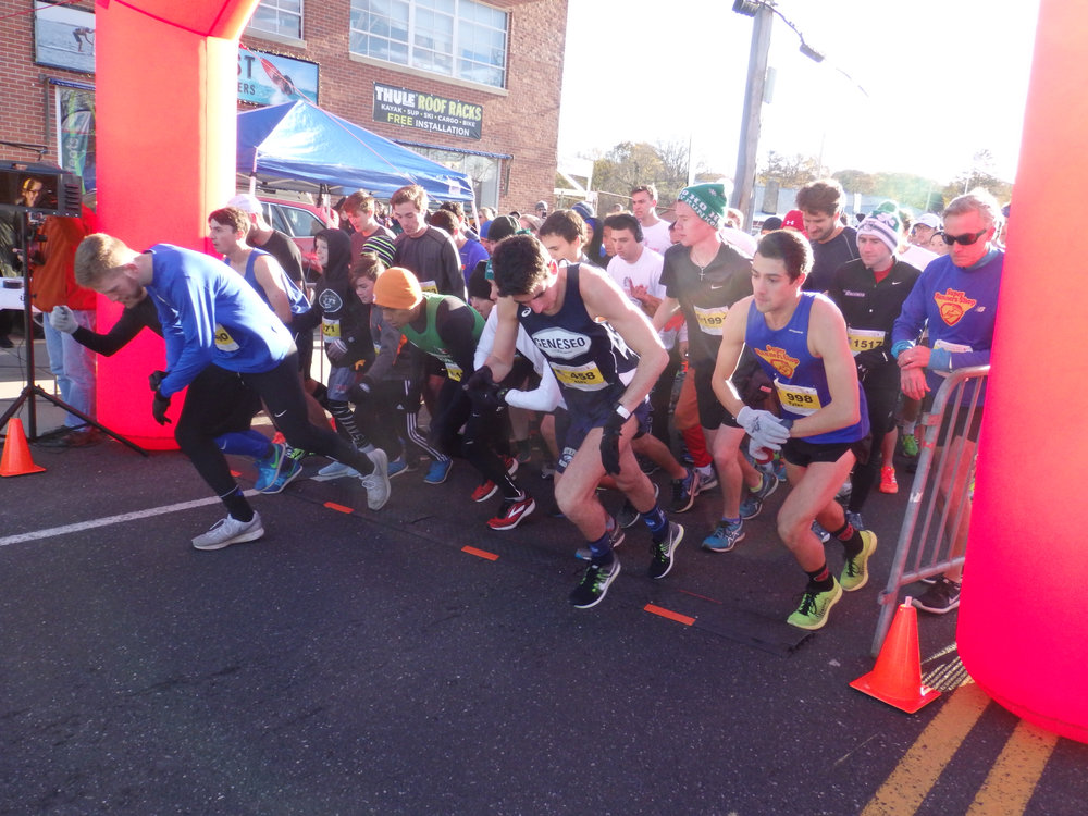Runners launch off the start line for the four-mile run.     Photo Courtesy of TWF of Huntington