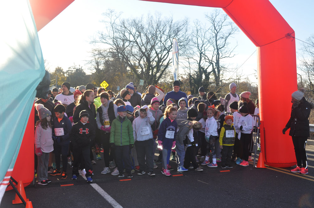 Runners prepare to pound the pavement at the Townwide Fund's Annual Thanksgiving Day Charity Run.   Photo Courtesy of TWF of Huntington
