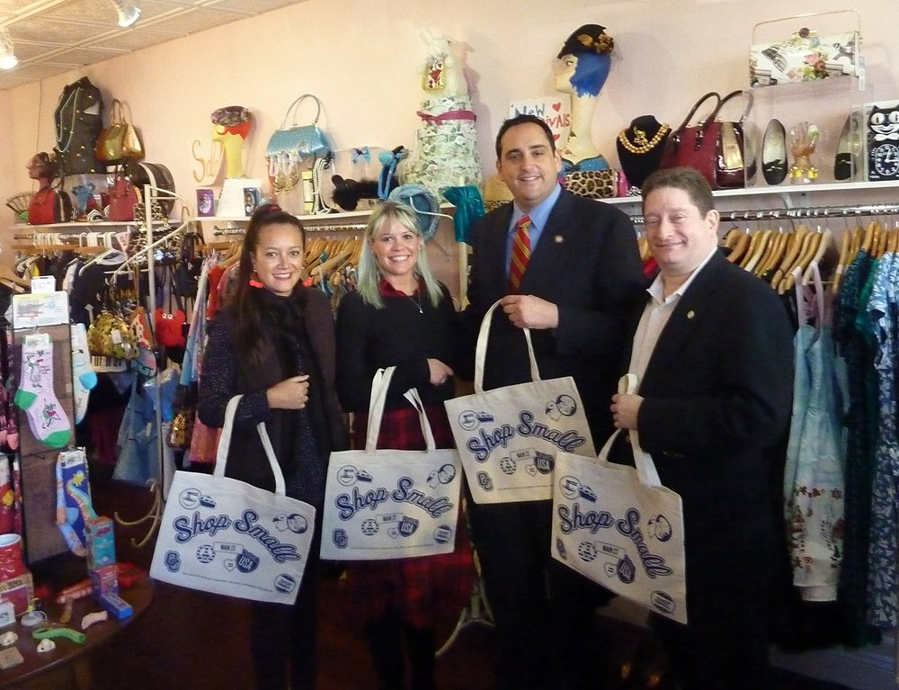Paper Doll Vintage Boutique employee Ali French, second from left, welcomed a visit from business and government representatives on Small Business Saturday. From left are: Andrea Bonilla of Renaissance Downtowns, French, Huntington Supervisor-elect Chad Lupinacci, and Chamber of Commerce Chairman Brian Yudewitz.   Long Islander News Photo/Peter Sloggatt