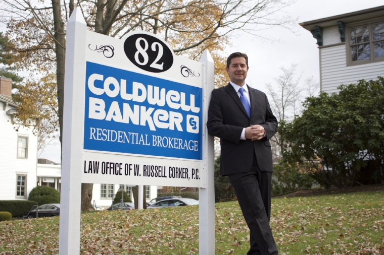 William McCartney, Coldwell Banker's regional vice president for Long Island and Queens, serves as office manager of its Huntington branch.   Long Islander News Photo/Janee Law
