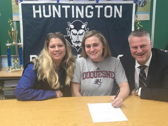 Sarah Agrillo, center, signs her Letter of Intent to Duquesne University in Pittsburgh  . Photo Courtesy of Huntington Village Lacrosse Club