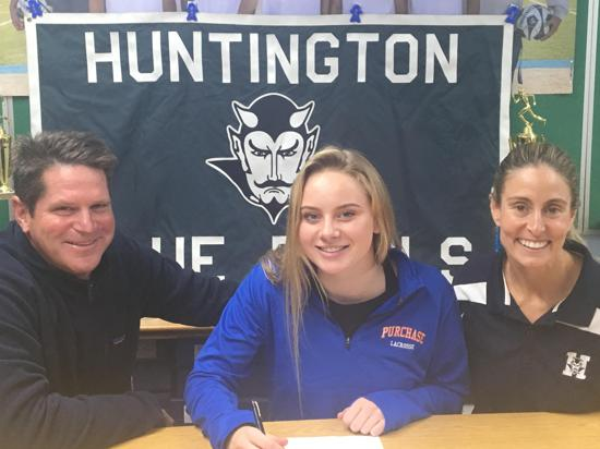 Sigrid Cassell, center, signs her Letter of Intent to the State University of New York at Purchase.   Photo Courtesy of Huntington Village Lacrosse Club
