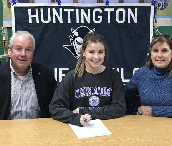 Emma Greenhill, center, has signed with James Madison University in Virginia.   Photo Courtesy of Huntington Village Lacrosse Club