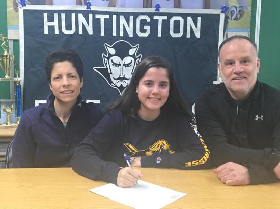 Izzy Piccola, center, commits to Pace University in Manhattan.   Photo Courtesy of Huntington Village Lacrosse Club