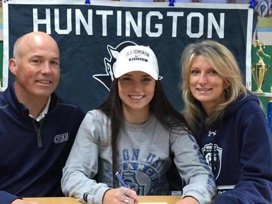 Amber Stieve, center, signs with Old Dominion University in Virginia.   Photo Courtesy of Huntington Village Lacrosse Club