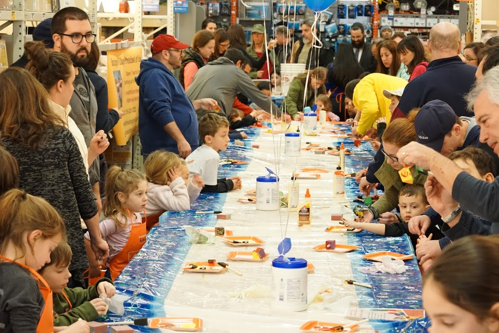 Children worked on their dreidels during the Chabad of Huntington Village's workshop at The Home Depot.   Photo Courtesy of Chabad of Huntington Village