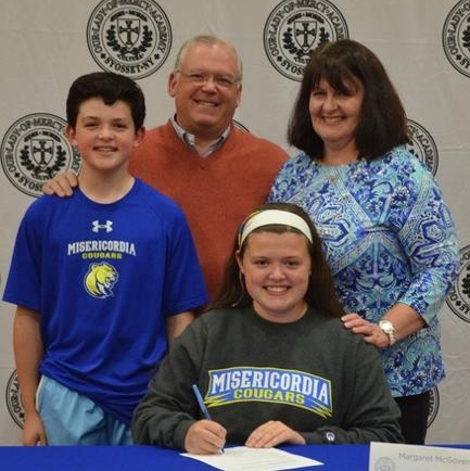 Maggie McGovern, seated, has committed to Misericordia University in Pennsylvania.   Photo Courtesy of Huntington Village Lacrosse Club