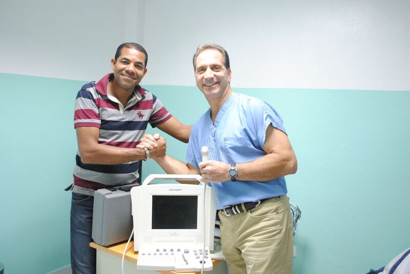 Dr. Ernest Vomero, of Centerport, donates an ultrasound machine to the village hospital in El Cercado in the Dominican Republic. Vomero is pictured with the hospital's medical director.   Photo courtesy of Dr. Ernest Vomero