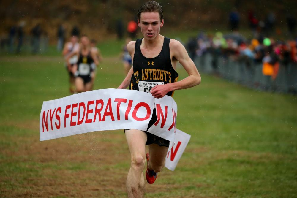 Mason Gatewood crosses the finish line at the New York State Federation Championships, where he came in first place with a 15:52.4 time.   Photo by John Nepolitan