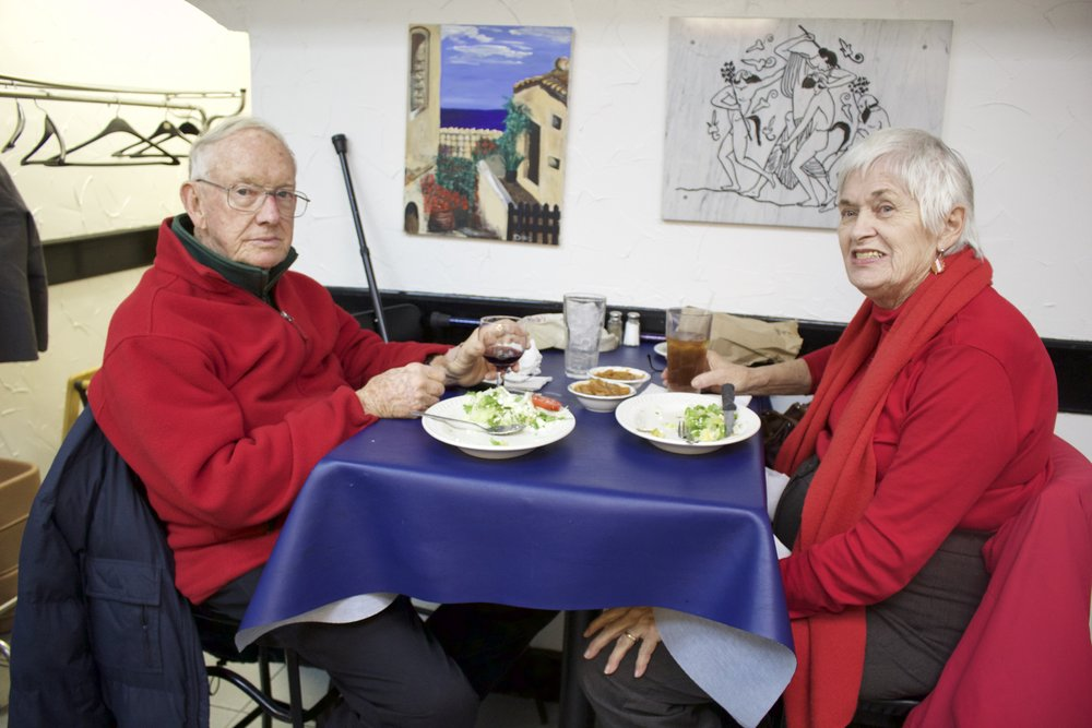 Ronald and Penny Hannington, of Huntington, longtime customers of Mediterranean Snack Bar, enjoy a last meal at the eatery before it closes this Saturday.   Long Islander News photo/Janee Law