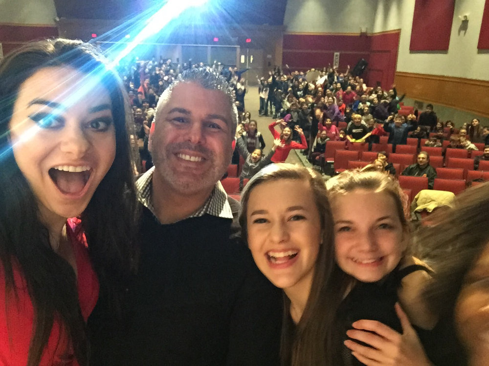 Pop star Meredith O'Connor, left, takes a selfie with Silas Woods' principle Steve Toto and the school's sixth graders during an anti-bullying presentation at Walt Whitman High School.      Photo Courtesy of Lisa Termini