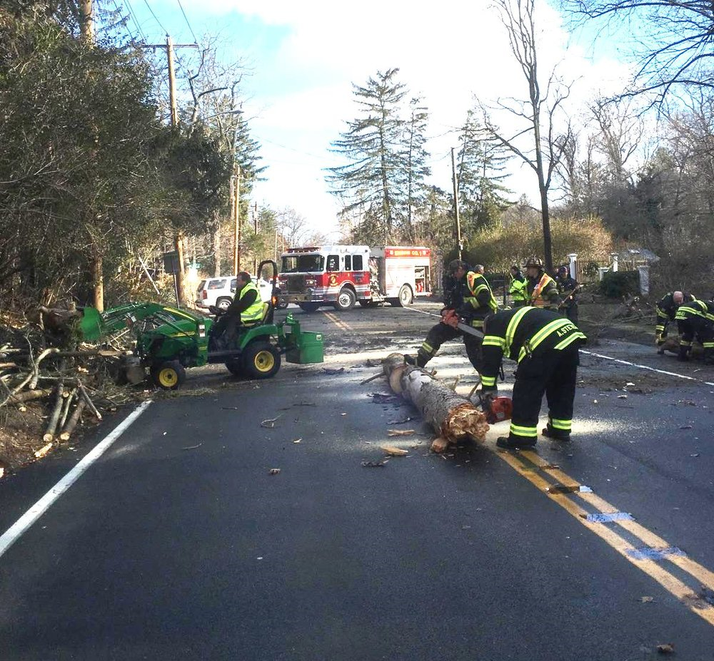 Centerport fire fighters work to remove a fallen tree from Route 25A in Centerport on Christmas morning   Photo/Centerport FD