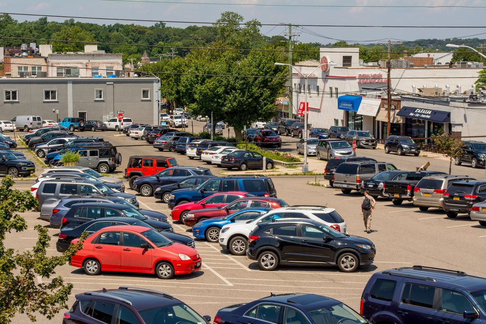 A bird's-eye view of the municipal parking lot between New and Green streets in Huntington village, where the town is considering building a parking structure.