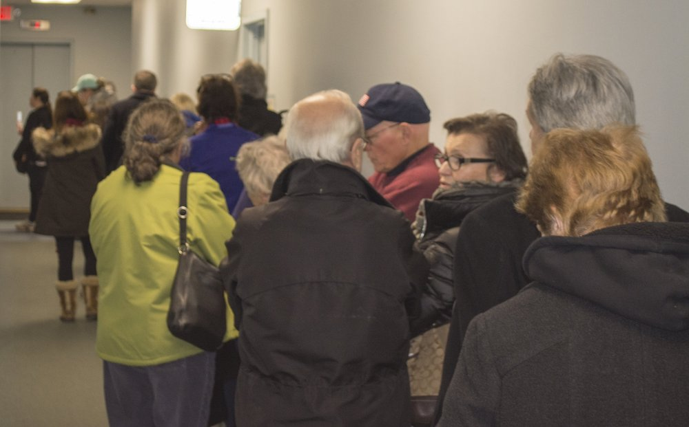 Huntington residents line up at town hall Wednesday afternoon to pay their property taxes. Over 1,900 people flooded the tax receiver's office throughout the day, causing wait times nearing two hours.   Long Islander News photo/Connor Beach