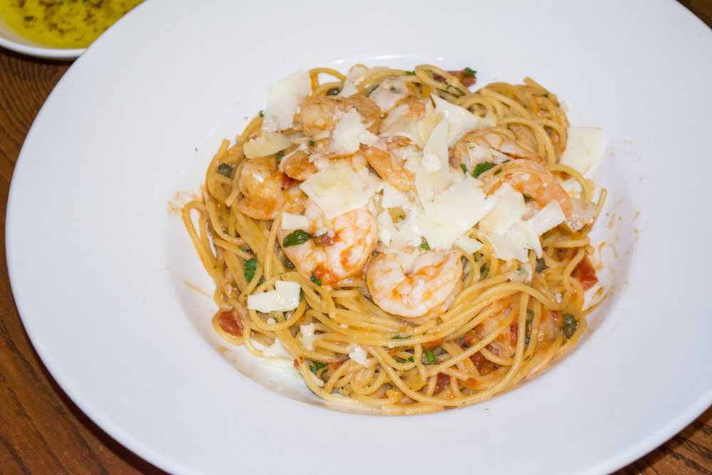 The Shrimp Rossini ($16.99) features sautéed shrimp served over spaghetti in a tomato cream sauce with capers.   Long Islander News photos/Connor Beach