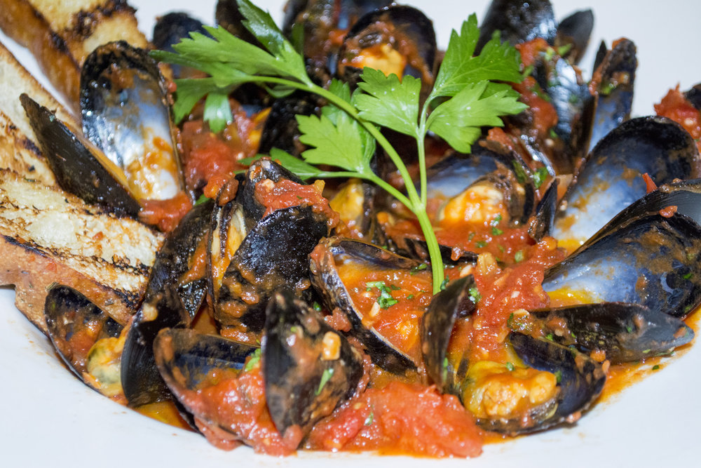 Pan Sautéed Mussels ($12.99) features Price Edward Island mussels sautéed in red sauce with chopped garlic, onions, cherry peppers, chunky tomatoes and Italian parsley.   Long Islander News photos/Connor Beach