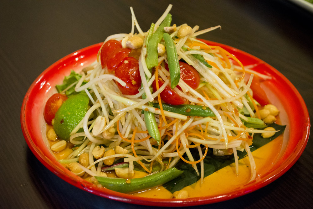 The Som Tum, or Papaya Salad, ($8) combines green papaya, tomato, green beans, peanuts, chili and pepper in a lime sauce.   Long Islander News photos/Connor Beach
