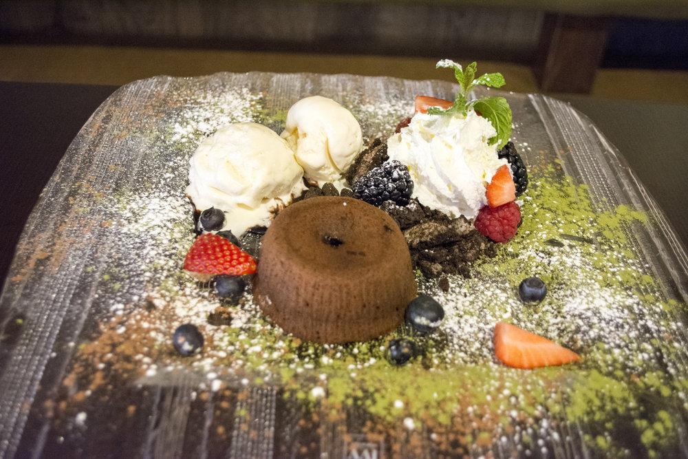Chocolate Lava Cake ($8) is served with vanilla ice cream and fruit.   Long Islander News photos/Connor Beach
