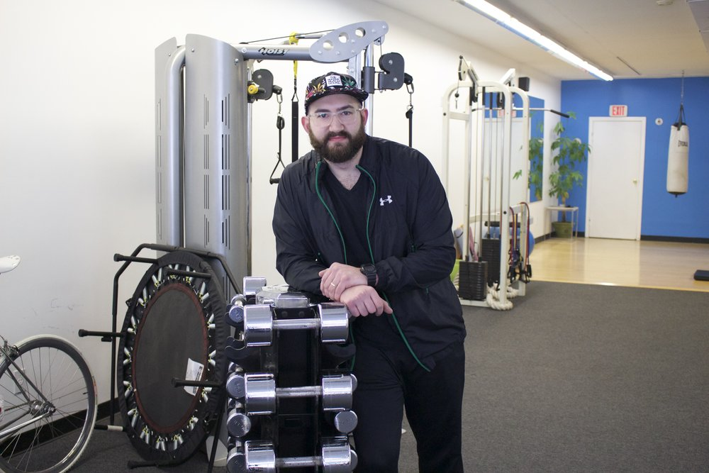 Michael Dubas, owner of SimplyFit Health and Wellness, developed a passion for fitness while in high school and opened a personal training business in Centerport and Huntington.     Long Islander News photos/Janee Law