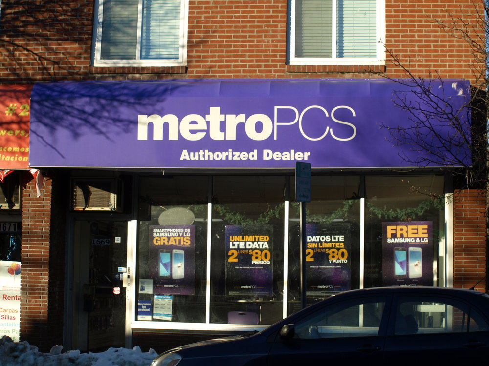 Two men armed with a shotgun robbed this MetroPCS store at 1669 New York Ave., Huntington Station on Monday, Suffolk police said.   Long Islander News photo/Connor Beach