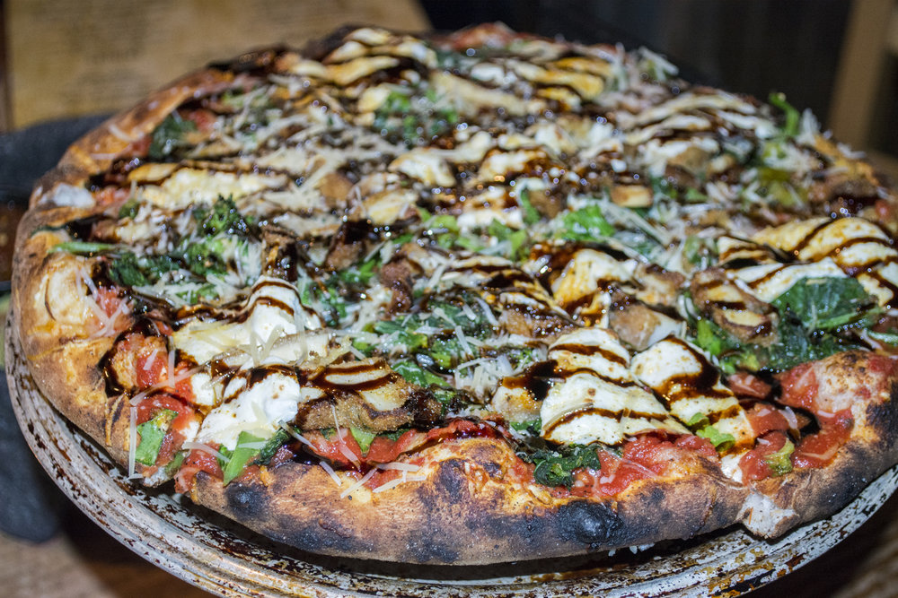 The Mamma Mia Pizza ($13.95) from The Refuge's pizza oven is topped with chicken cutlet, broccoli rabe, tomato, mozzarella, Parmesan and a balsamic drizzle.   Long Islander News photos/Barbara Fiore