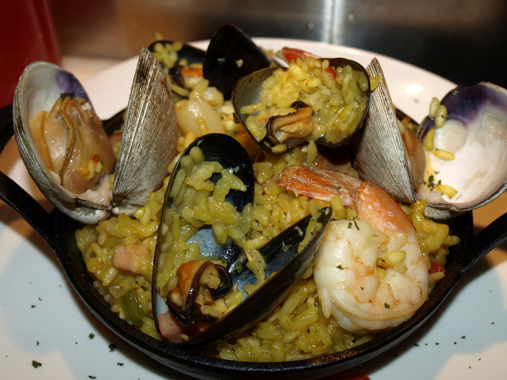 Seafood Paella ($18) with Arborio rice, chorizo, shrimp, mussels, clams and calamari, evokes images of the Carribean.     Long Islander News photos/Connor Beach
