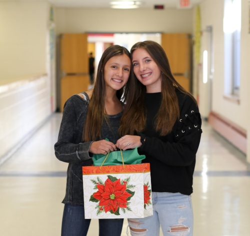 Morgan Mandel and Ashley Kalb raised $3,000 in gift donations to cancer-inflicted teens for the holidays and hope to continue their efforts.   Photo/Half Hollow Hills Central School District
