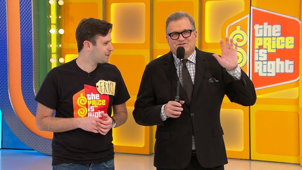 """Dix Hills resident Eric Rabinowitz, left, gets a walkthrough from """"Price Is Right"""" host Drew Carey.   Photos courtesy of Fremantlemedia North America"""