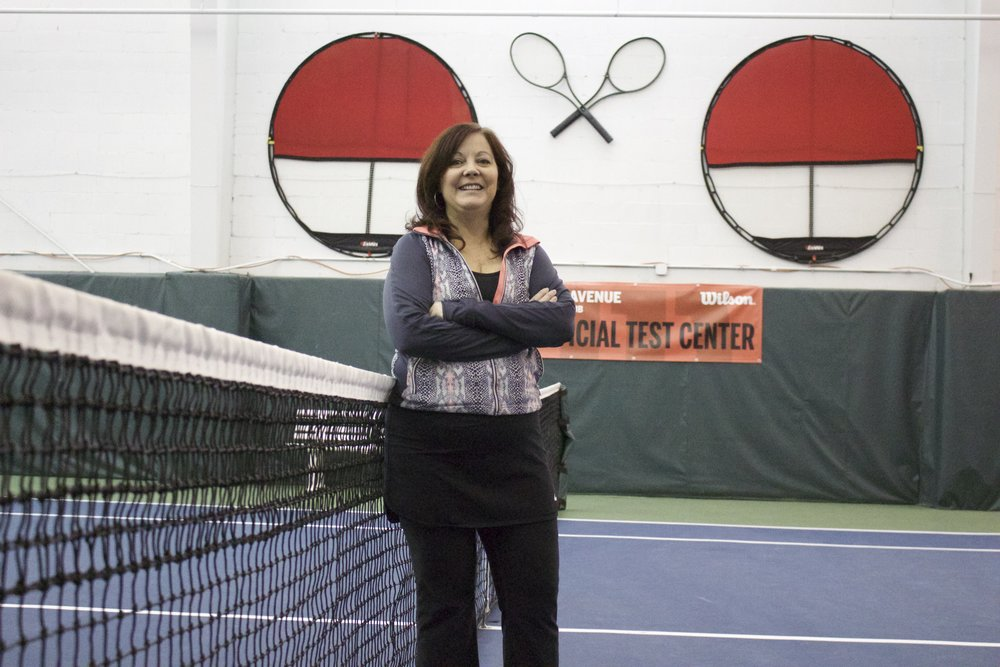 Karen Cadorette, new co-owner of Park Avenue Tennis Club with her husband Phil, stands on one of the four courts at the 100 Partridge Lane facility in Huntington.   Long Islander News photo/Janee Law