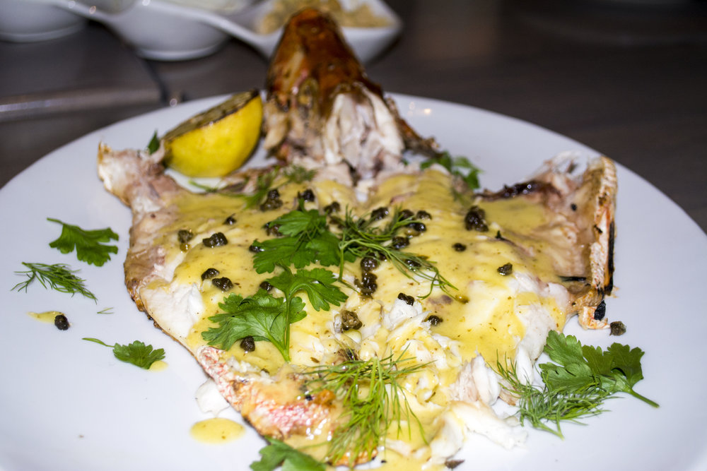The Red Snapper ($40) is cooked whole and served as is or butterflied with capers and a lemon sauce.   Long Islander News photos/Connor Beach