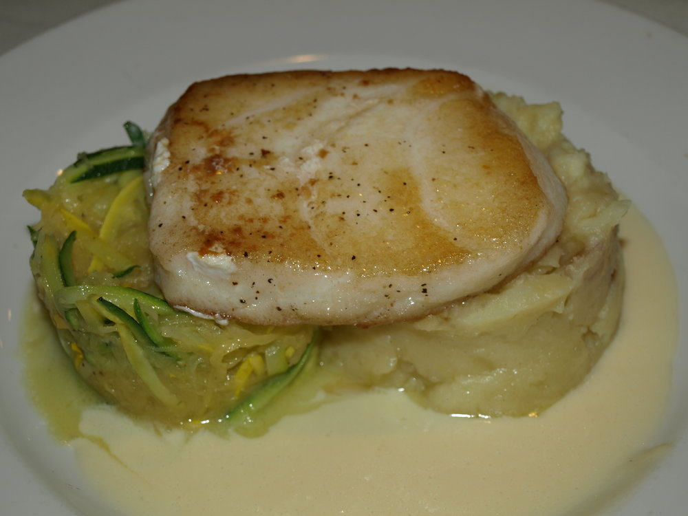 The Chilean Sea Bass ($34) is served with a chardonnay buerre blanc sauce, whipped potatoes, julienne zucchini and spaghetti squash.   Long Islander News photos/Connor Beach