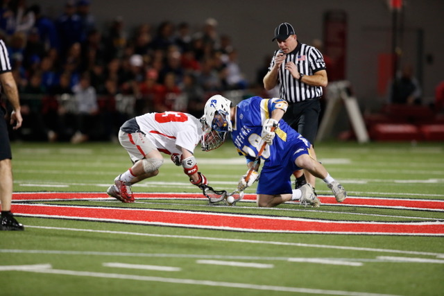Hofstra University faceoff specialist Kyle Gallagher, right, a Northport native and 2016 St. Anthony's grad, wins a draw against Ohio State on Feb. 17.