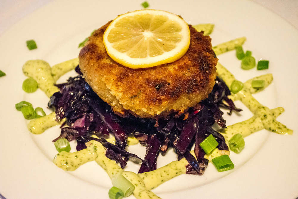 The Torta de Cangrejo ($13) is a jumbo lump crab cake tossed in panko breadcrumbs and served with basil aioli and sautéed red cabbage.   Long Islander News photos/Connor Beach
