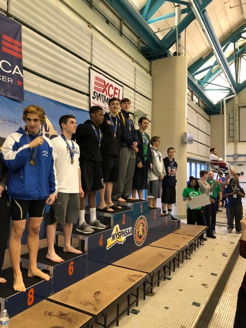 Ethan Tack stands in second on the podium for his performance in the 100-yard butterfly.   Photos courtesy of Nina Cunningham
