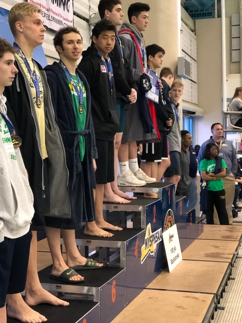 Standing in fourth place for the 100-yard backstroke is Half Hollow Hills' Dylan Chan.