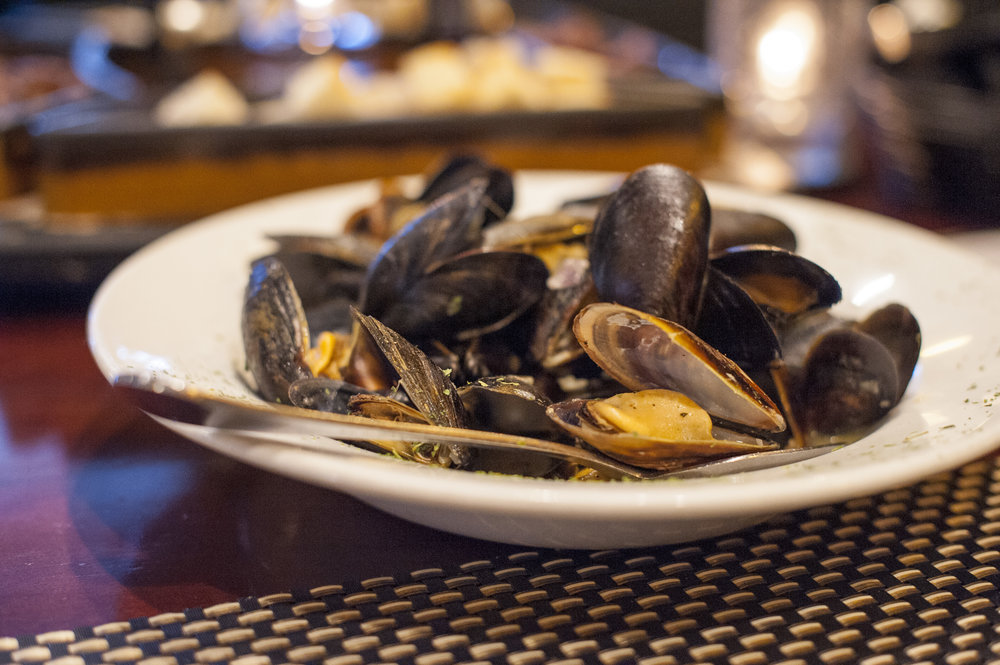 The P.E.I. Mussels are available with either white wine garlic sauce or fra diavolo – they're on the $40 menu at Black & Blue as an appetizer choice.