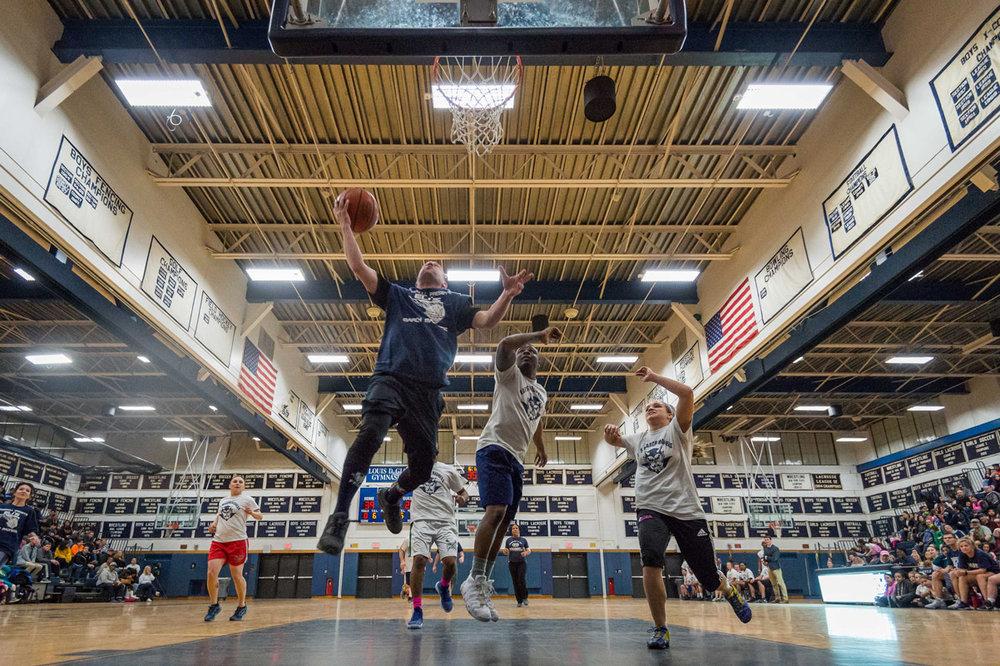 Woodhull teacher Jason Suarez leaps to the basket.   Photos/Darin Reed