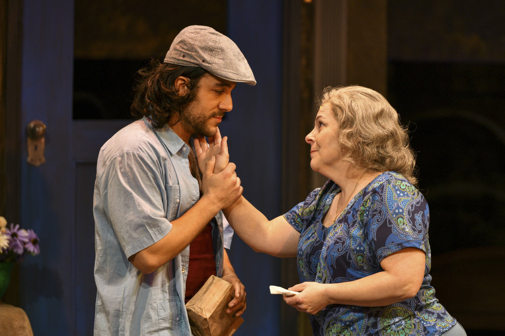 Spiro Marcos (Usnavi) and Tami Dahbura (Abuela Claudia) portray the touching relationship between mother and son.   Photos by Michael DeCristofaro