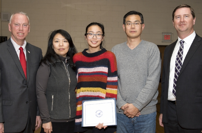 Half Hollow Hills High School East sophomore Cassandra Ye, center, pictured with, from left, Suffolk Legislator Tom Donnelly; her mother Shu Song; her father Shengyi Ye; and Half Hollow Hills Assistant Superintendent of Secondary Education John O'Farrell.   (Photo/Office of Suffolk Legis. Tom Donnelly)