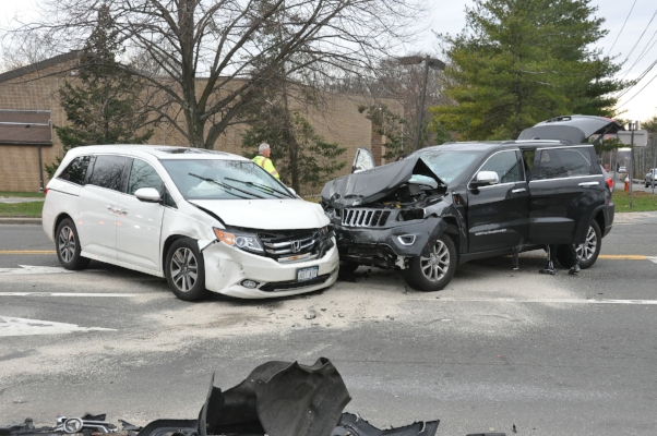 Two of the four cars involved in a crash in Melville on Friday.   (Photo/Steve Silverman)
