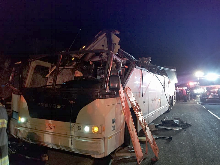 State Police said there were no signs that the driver attempted to stop the bus, pictured, before slamming into an overpass and crushing the roof.   (Photo/Heather McNeill)
