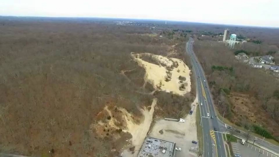 A bird's-eye view of the site at the northwest corner of Jericho Turnpike and Manor Road where developer Villadom wants to build a 486,380-square-foot commercial center.   (Photo/Facebook/Stop the Villadom Mall)