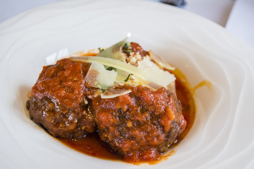 Le Polpette (three for $8) are hand-crafted beef and pork meatballs hand-rolled with fresh herbs and simmered in a Sunday-style sauce.