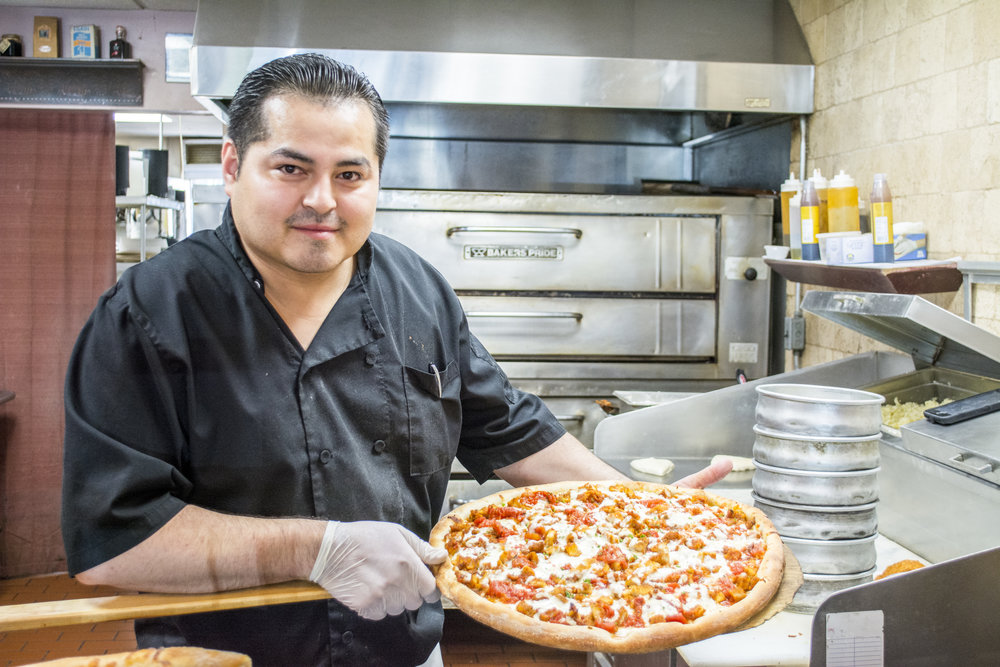 Owner Donaldo Escobar reopened Fattusco's three months ago and has since been serving up chicken parm pizza, pictured, and other delicious Italian favorites.   (Long Islander News photos/Sophia Ricco)