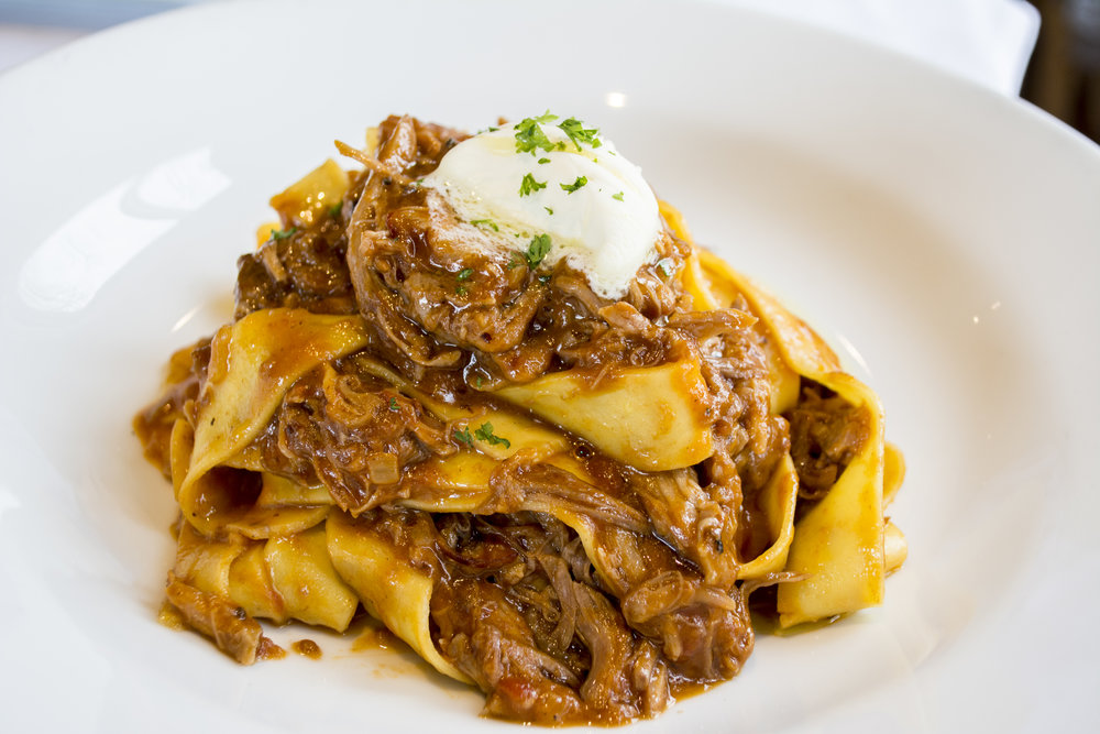 Pasta Pappardelle, served with pork shank osso bucco ragu and topped with mascarpone cream.