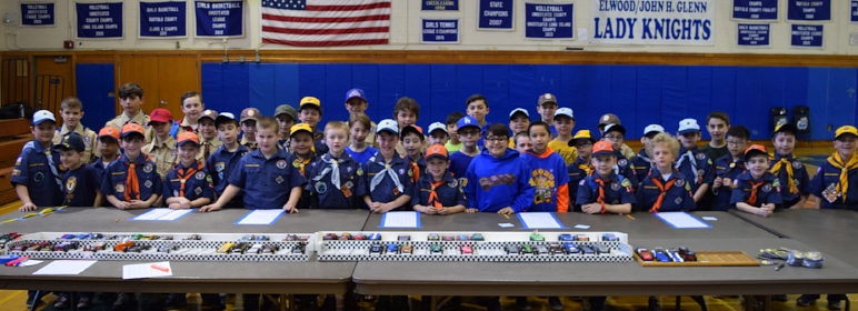Prior to the start of the Matinecock District's annual pinewood derby race, all of the participating Tigers, Cubs and Webelos pose for a photo with the racecar entries.   (Photos courtesy of Phyllis Stein)